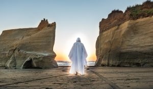 Jesus walking between to cliffs into the light.